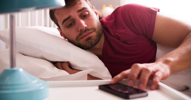 Man-In-Bed-Woken-By-Alarm-On-Mobile-Phone-640x337